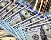 الدولار يهبط بفعل تراجع العائدات الأمريكية